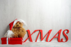 Teddy bear in santa hat with gifts Royalty Free Stock Image