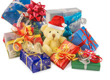 Teddy bear with Santa hat and gifts on white. Stock Images
