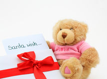 Teddy bear with santa wish sheet Royalty Free Stock Photos