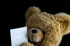 Teddy Bear with save me note. stock photography