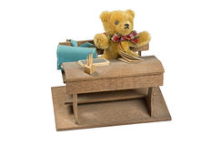 Teddy bear in school studying on a wooden desk Stock Photo