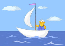 Teddy-bear seaman. Floats on a sailing vessel on the dark blue sea Stock Photography