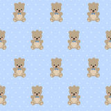 Teddy Bear seamless pattern on baby blue polka dots background. Cute vector with baby bear. Design for print on babys clothes, textile, baby shower, wallpaper Royalty Free Stock Images