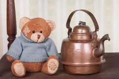 Teddy bear on the shelf with retro kettle still life Stock Images