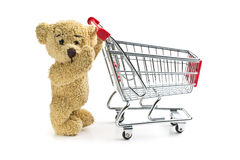 Teddy bear with shopping cart Stock Photography