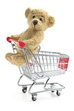 Teddy bear with shopping cart Royalty Free Stock Photo