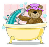 Teddy bear showering in bath Royalty Free Stock Images