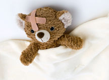 Teddy bear is sick stock images