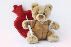 Teddy bear. Sick teddy bear whit water bag,fever thermometer and syringe injection Royalty Free Stock Image