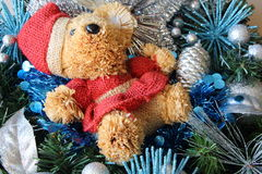 Teddy bear, silvery Christmas balls and blue tinsel on a Christmas wreath Stock Photography