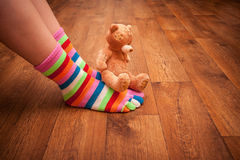 Teddy bear sits on legs Royalty Free Stock Images