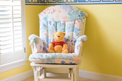 Teddy bear sitting in the armchair Stock Image