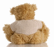 Teddy bear sitting backwards Royalty Free Stock Photography