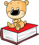 Teddy bear sitting on book  on white Stock Images