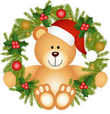 Teddy bear sitting in a Christmas wreath Royalty Free Stock Images