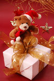 Teddy bear sitting on gift box Royalty Free Stock Images