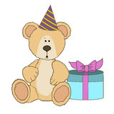 Teddy Bear is sitting with gift box Stock Images