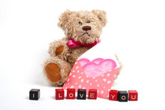 Teddy bear sitting  with heart. Valentine's day Stock Photography
