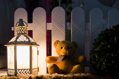 Teddy Bear Sitting Near Lamp Stock Image