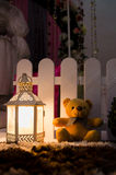 Teddy Bear Sitting Near Lamp Royalty Free Stock Images