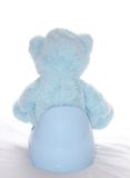 Teddy bear is sitting on the potty royalty free stock images