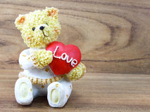 Teddy bear sitting with a red heart Stock Images