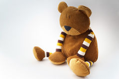 Teddy bear. Sitting sad toy teddy bear stock image