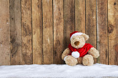 Teddy bear sitting in the snow Royalty Free Stock Photo