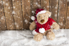 Teddy bear sitting in the snow stock photos