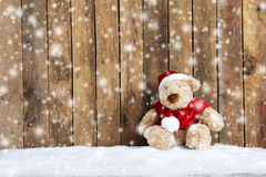 Teddy bear sitting in the snow Stock Images