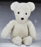 Teddy bear sitting on snow Stock Images