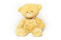 Teddy bear sitting. Soft plush cute yellow teddy bear is sitting, on white stock photography