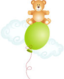 Teddy bear sitting on top balloon Stock Photography