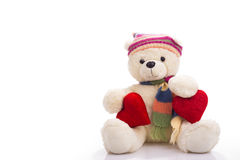 Teddy bear sitting with two valentine hearts Royalty Free Stock Photo