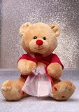 Teddy bear sitting on a white background stock photography