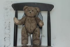 Cute teddy bear stand on seat Royalty Free Stock Photography
