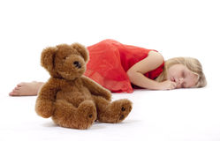 Teddy Bear and sleeping girl Royalty Free Stock Image