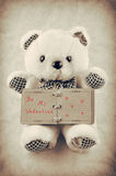 Teddy bear with a small old notepad Stock Photography