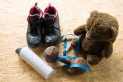 Teddy bear with sneakers, Dumbbells and tape,Sport equipment Stock Images