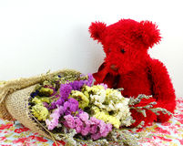 teddy bear and statice flower bouquet with printed fabric Stock Photos