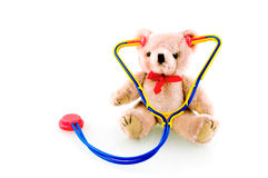 Teddy bear with stethoscope. Isolated on white background stock photography