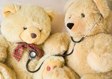 Teddy bear and stethoscope. Teddy bears with stethoscope posing as doctor and patient. Ideal to illustrate paediatrics Royalty Free Stock Photos