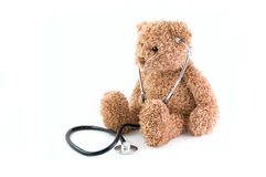 Teddy bear and stethoscope. Royalty Free Stock Images