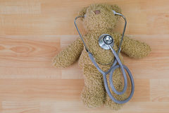 Teddy bear with stethoscope, acoustic medical device with earpie Stock Photo
