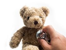 Teddy Bear with stethoscope isolated white background, Health life stock photography
