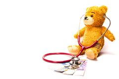 Teddy Bear with Stethoscope and Swiss Franc stock photos