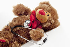 Teddy bear with stethoscope on white background Royalty Free Stock Photos