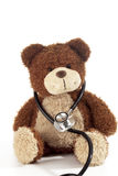 Teddy bear with stethoscope on white background Royalty Free Stock Images