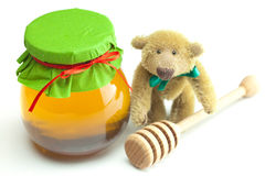 Teddy bear ,stick to hohey  and  jar of honey Stock Photos