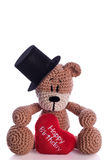 Teddy bear with stovepipe. And happy birthday heart pillow Royalty Free Stock Photo